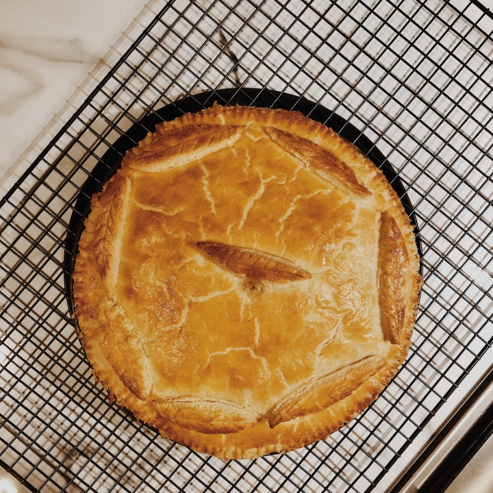 Looking down on a homemade chicken and mushroom pie.