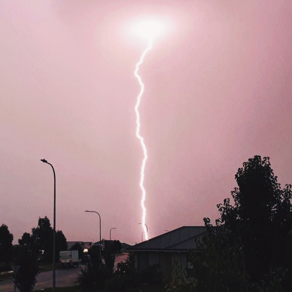 Lightning bolt strikes the distant ground in suburban Wagga Wagga, New South Wales, Australia.