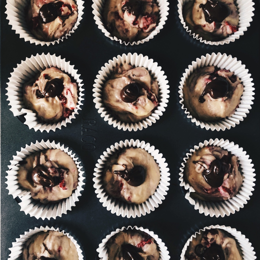 Raspberry and chocolate hazelnut swirl muffins ready to go in the oven.