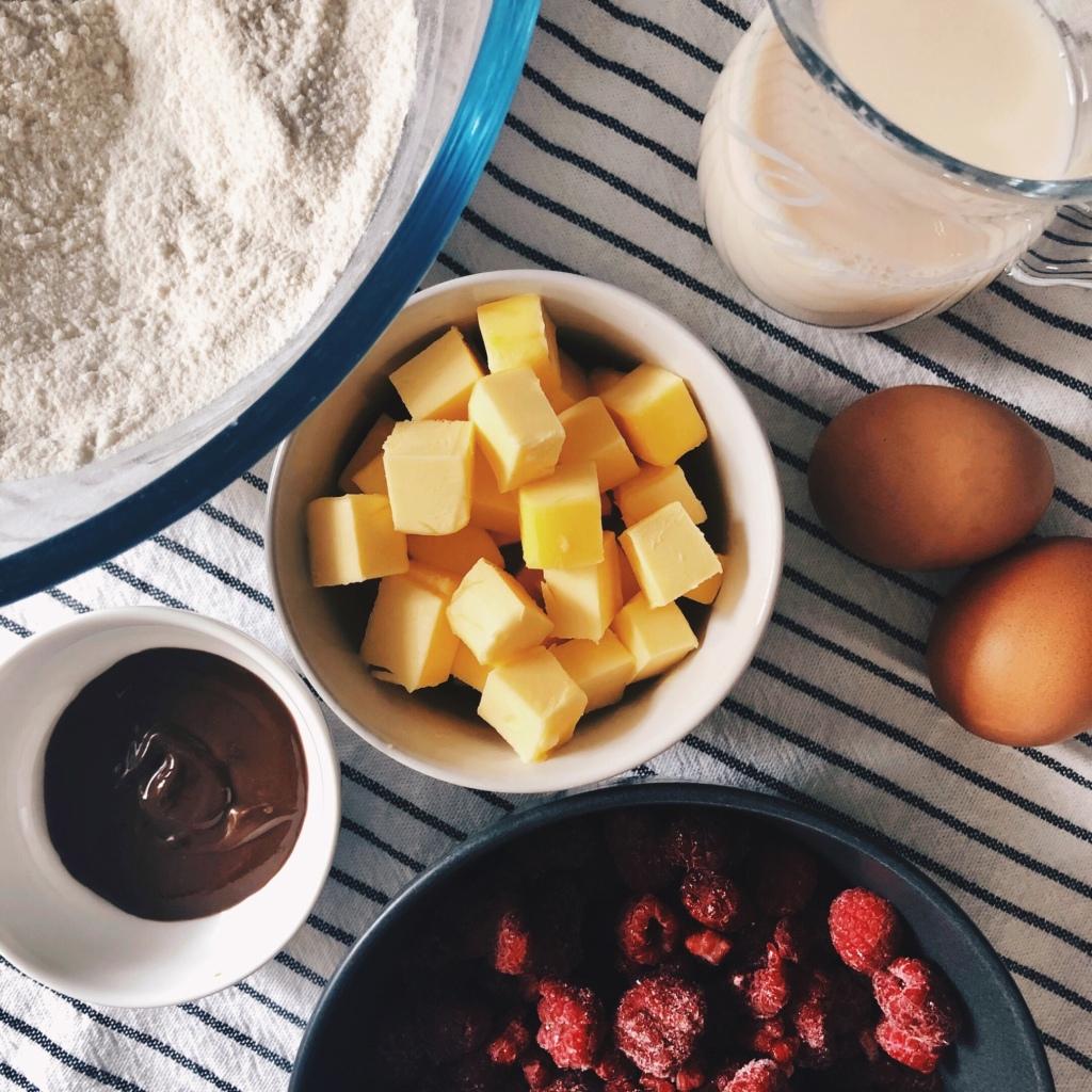 Ingredients for raspberry and chocolate hazelnut swirl muffins.